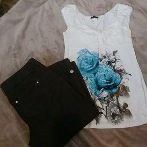 Ivory cap sleeve shirt with flower decor.